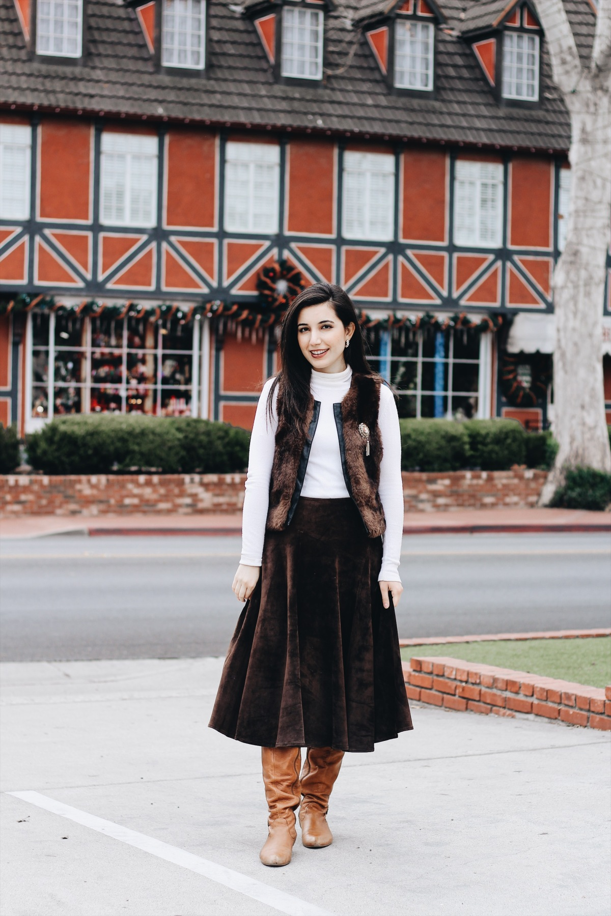 Solvang, CA, ALDO boots, fur vest, ootd, outfit of the day, California, CA, suede skirt, Jones New York, cameo brooch, white turtleneck, European, European outfit, lookbook, fashion blogger, travel