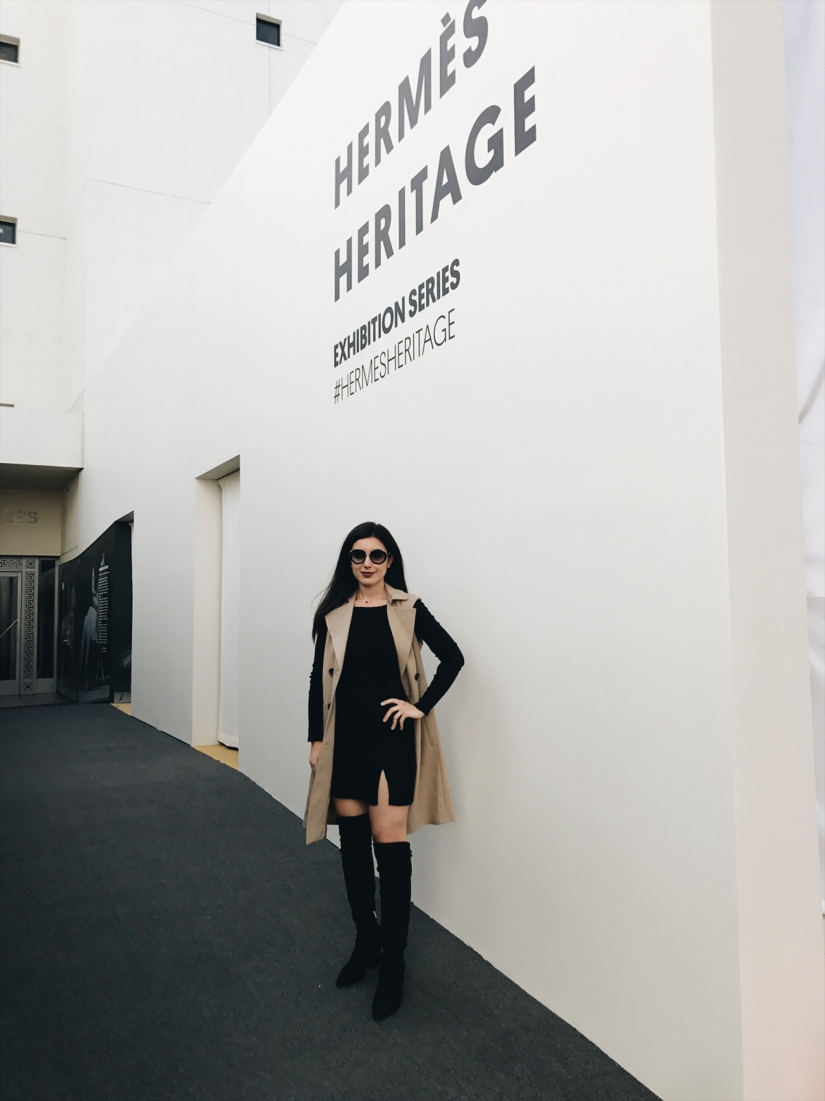 Hermes Heritage Beverly Hills Exhibition, Hermes, fashion, fashion exhibits, museum pop up, high fashion, Los Angeles Beverly Hills, fashion blogger, over-the-knee boots, black suede boots Prada sunglasses, trench coat, black skirt, black crop top