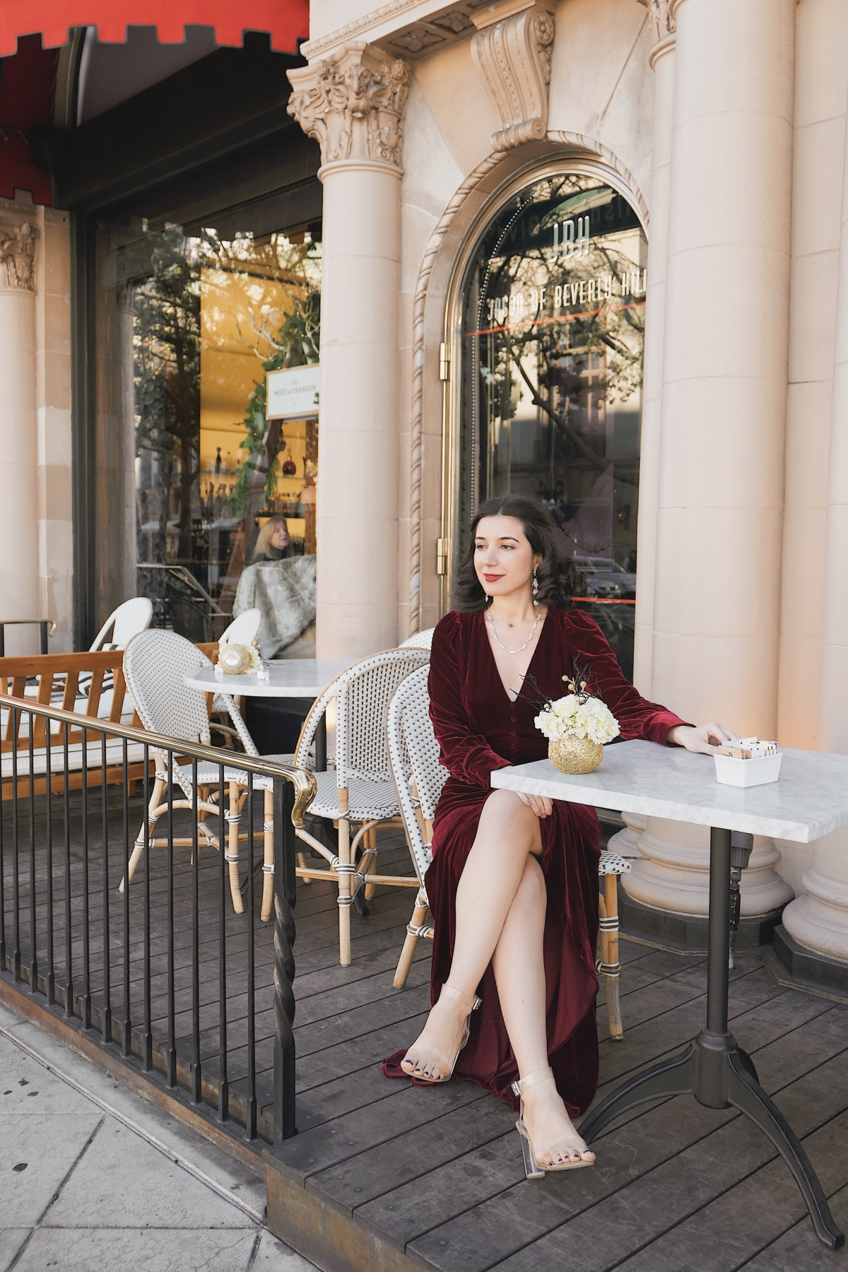 The Beverly Wilshire, red velvet, Christmas dress, Christmas outfit, gown, red velvet, fashion blogger, LA blogger, Beverly Hills, Christmas in Beverly Hills, Christmas in Los Angeles, high fashion, luxury, Edwardian, vintage, rhinestone necklace, rhinestone earrings, Nanamacs, Jeffrey Campbell shoes, curly hair, red lips